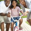 Stock Photo: AfricAmericFamily WIth Girl Riding Bike & Happy Parents