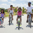 Stock Photo: African American Family Parents and Children Cycling