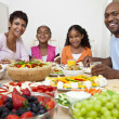 African American Parents Children Family Eating At Dining Table - Stock Photo
