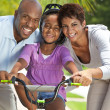 African American Family WIth Girl Riding Bike & Happy Parents — Stock Photo #21711885