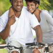 Happy African Man & Woman Couple Riding Bike Smiling — Stock Photo #21712009