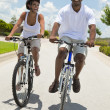 Stock Photo: African American Adult Man and Woman Couple Cycling