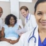 Female Hispanic Latina Hospital Doctor & Patient — Stock Photo
