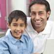 Asian Indian Father & Son Using Laptop Computer at Home — Stock Photo