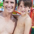 Father Son Man Boy Child Family at Water Park - Stock Photo
