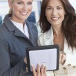 Two Businesswomen or Women Using Tablet Computer — Stock Photo