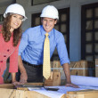 Man & Woman In Hard Hats on Construction Site — Stock Photo