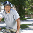 Stock Photo: Fit & Healthy African American Man Riding Bike