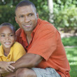 Stock Photo: Happy African American Father and Son Family Outside