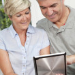 Stock Photo: Happy Man & Woman Couple Using Tablet Computer
