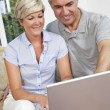 Stock Photo: Man & Woman Couple Using Laptop Computer At Home