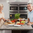 Man Woman Couple Making Sandwiches in Kitchen - Stock Photo