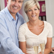 Man & Woman Couple Drinking Champagne In Kitchen — Stock Photo