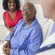 Senior African American Man Patient in Hospital Bed - Stock Photo