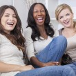 Interracial Group of Three Beautiful Women Friends Laughing — Stock Photo