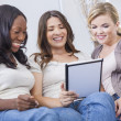 Stock Photo: Young Women Using Tablet Computer At Home