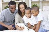 African American Family Using Tablet Computer — Stock Photo