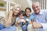 Grandparents & Children Family Playing Video Console Games — Foto Stock