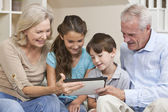 Seniors & Children Grandparents & Grandchildren Using Tablet Com — Stock Photo