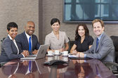 Interracial Men & Women Business Team Meeting in Boardroom — Stock Photo