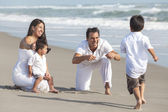 Mother, Father & Children Hispanic Family At Beach — Stock Photo