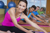 Interracial Group of Middle Aged Practicing Yoga — Stock Photo