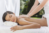 Woman Relaxing At Health Spa Having Massage — Foto de Stock