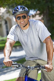 A Fit and healthy African American Man Riding Bike — Stock Photo