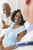 Senior African American Woman Patient in Hospital Bed — Stock Photo