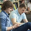 Male Boy Students Using Tablet Computers in Library — Stock Photo