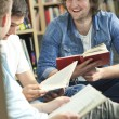 Happy Students Reading Books In Library — Stock Photo