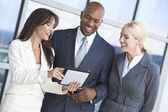 Interracial Business Team Using Tablet Computer — Stock Photo