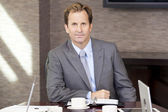 Businessman Sitting in Office Boardroom — Stock Photo