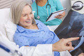 Happy Senior Woman Patient in Hospital Bed — Stock Photo