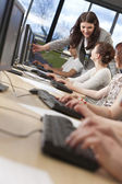 Student & Teacher Using Computers at College — Stock Photo