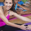 Interracial Group of Middle Aged Practicing Yoga - Stock Photo