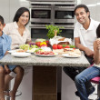 Asian Indian Parents Children Family Eating Healthy Food in Kitc - Stock Photo