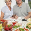 Stock Photo: Middle Aged Couple Healthy Eating Salad Table