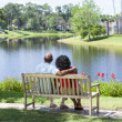 Stock Photo: Senior African American Couple Sitting On Park Bench