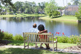 Senior African American Couple Sitting On Park Bench — ストック写真