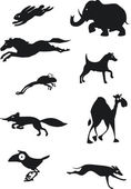 Set of black animal silhouettes — Stock Vector