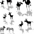 Set of black animal silhouettes — Stock Vector #27459629