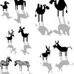 Set of black animal silhouettes — Stock Vector