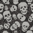 Stock Photo: Seamless pattern with skulls