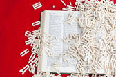 Letters are scattered on the book — Stock Photo