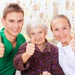 Stock Photo: Elderly woman with the young doctors