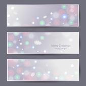 Christmas banners with green bokeh — Stock Vector