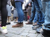 Feet of waiting in a crowd — Stock Photo