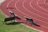 Benches on running track — Stock Photo