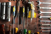 Tools of a mechanical workshop, on a wall — Stock Photo